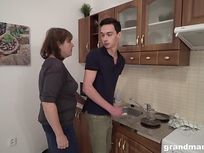 Sex-starved old landlady bangs young tenant right in the kitchen