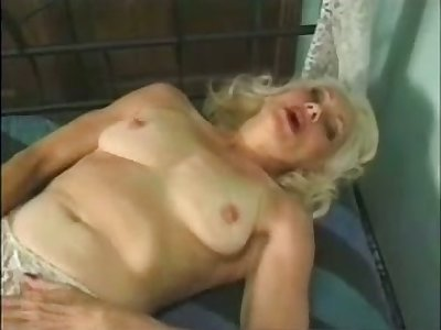 Mature auburn whore masturbates her drenched old pussy with a toy