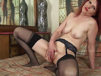 Redhead mature Cee Cee takes off her clothes to masturbate