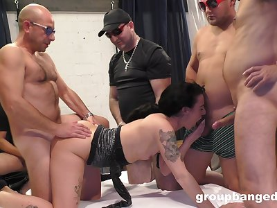 Perturbed woman gangbang fucked in a submissive XXX work